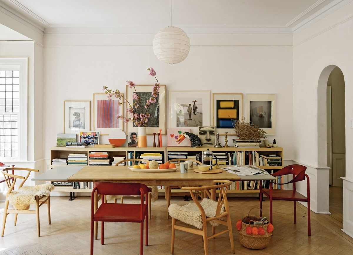 All the artwork in this five-bedroom Colonial Revival was done by friends of the owner, who shot the two photographs that sit on the bookcase while in India.