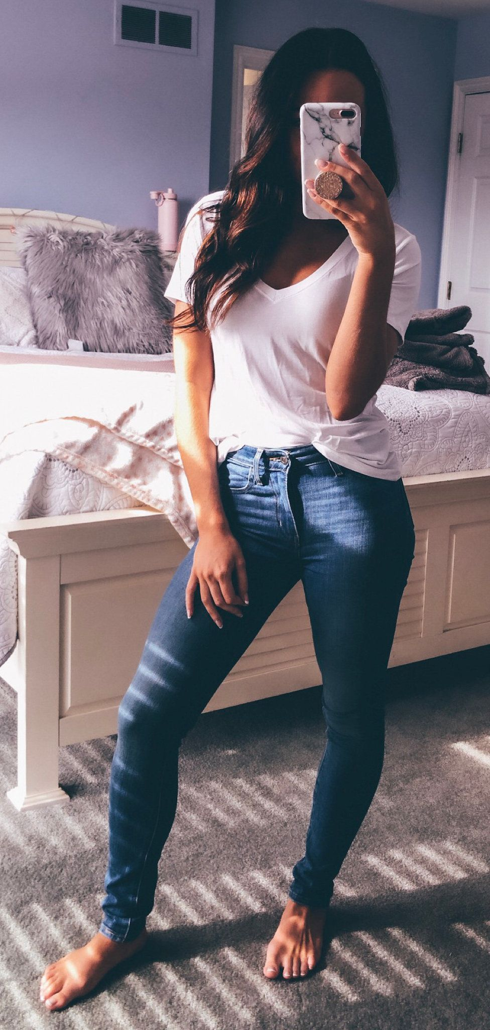 white V-neck t-shirt and blue denim jeans #spring #outfits