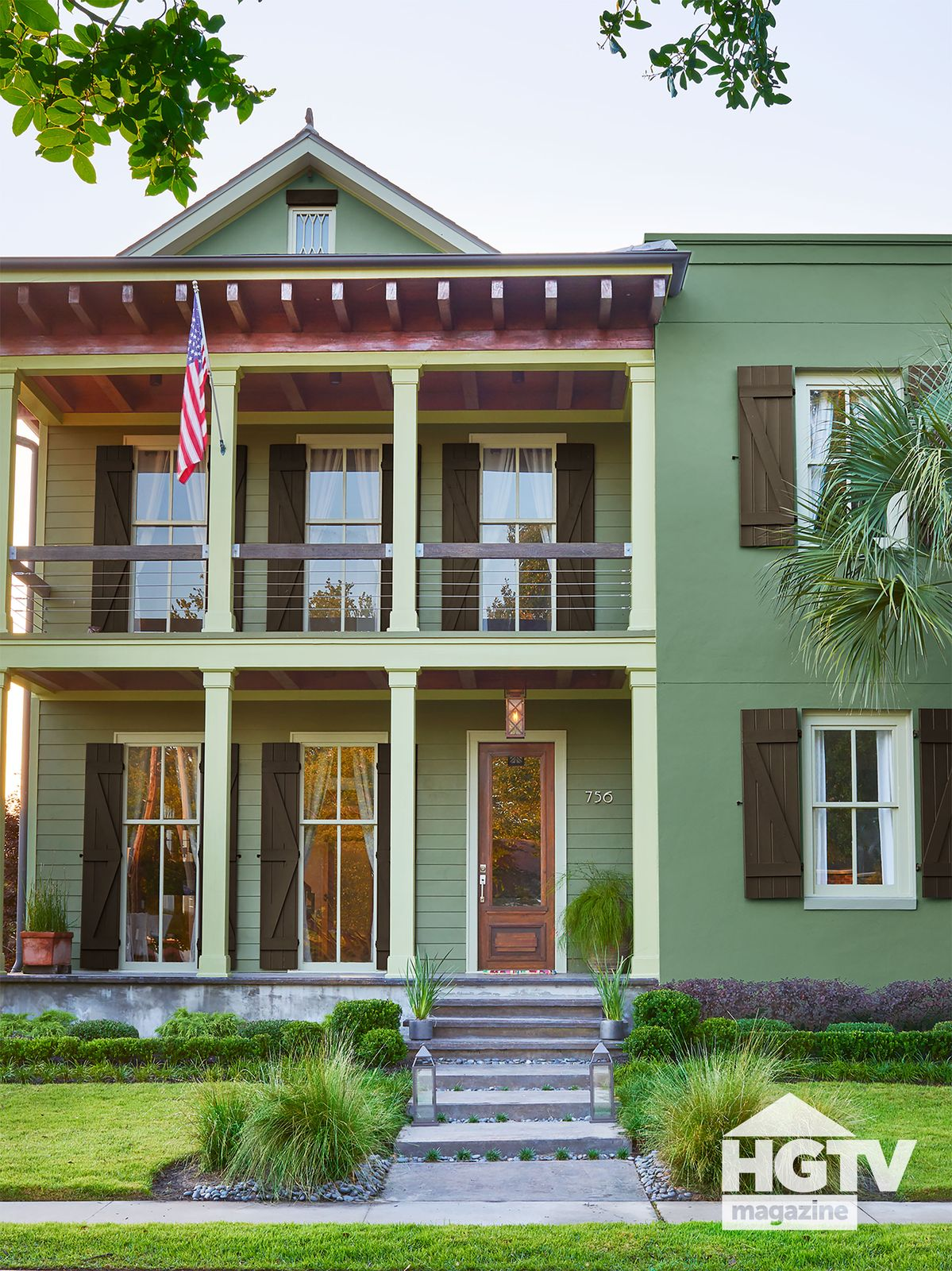 A green, two-story home from HGTV Magazine