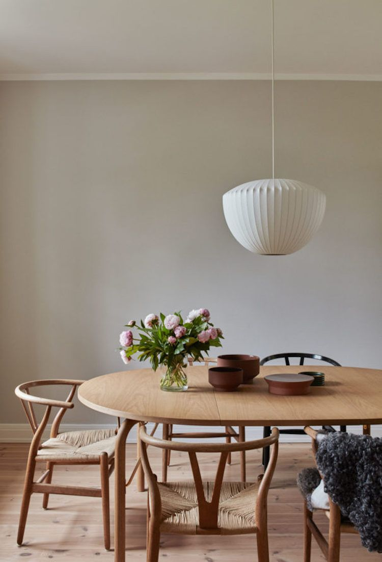 Wishbone chairs and wood dining table / Skagerak
