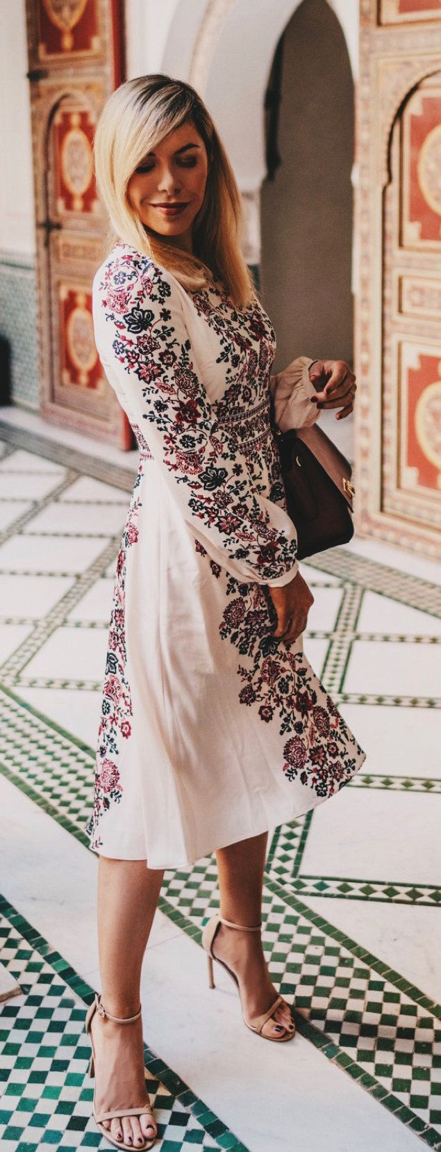 white, black, and red floral dress