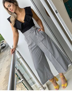 Black top, plaid skirt pants and yellow sandals