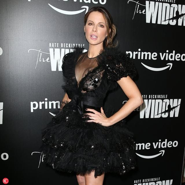 Actress Kate Beckinsale, wearing a little black lace cocktail dress, attends the premiere of 'The Widow' at Crosby Hotel