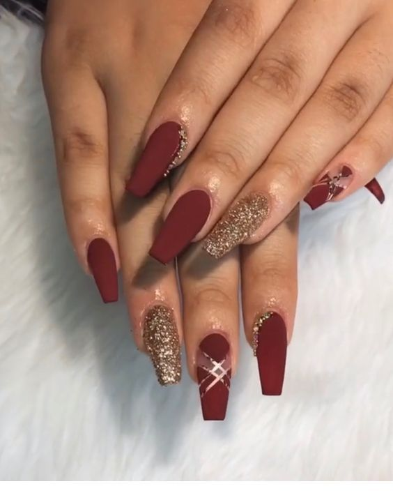 Burgundy and gold – nails