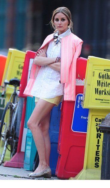 White shirt, yellow shorts and pink jacket