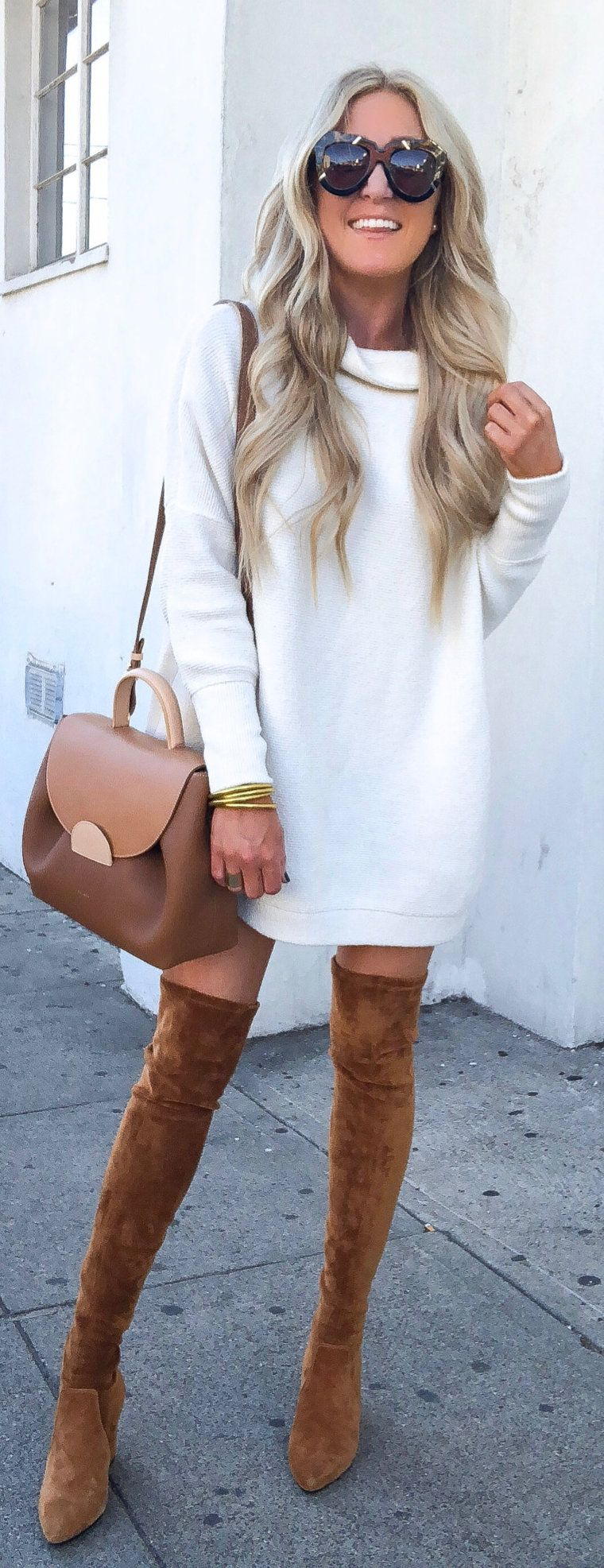 white sweatshirt and pair of brown thigh-high boots