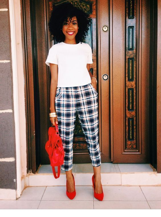 White top, plaid pants and red details