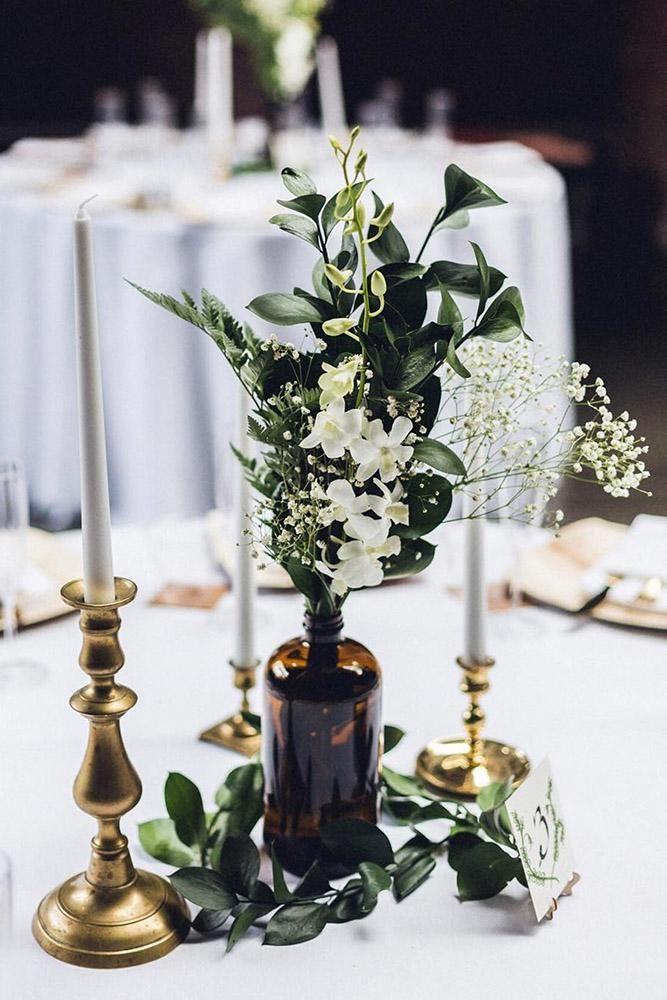 36 Inspirational Bridal Bohemian Decor Ideas ❤ bohemian decor ideas glass bottle with white flowers and gold candlesticks danilamednikov via instagram #weddingforward #wedding #bride #bohemiandecorideas