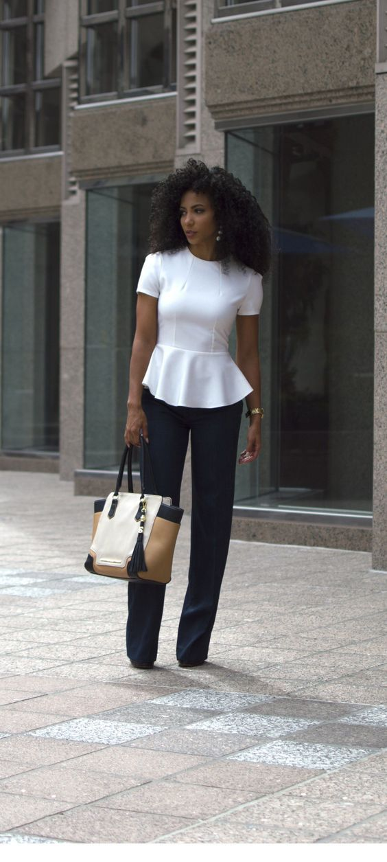 White top, black pants and a classy bag