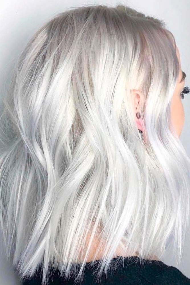 Ice Blonde Layered Hairstyle #iceblondehair #wavyhairstyle ★ Medium length hairstyles have a big number of perks, and that is why women all around the world choose to sport them. Any woman can find a flattering style for her. To help you do that, we have created a photo gallery featuring the most complimenting styles. Check it out and pick a new style. #glaminati #lifestyle #mediumlengthhairstyles