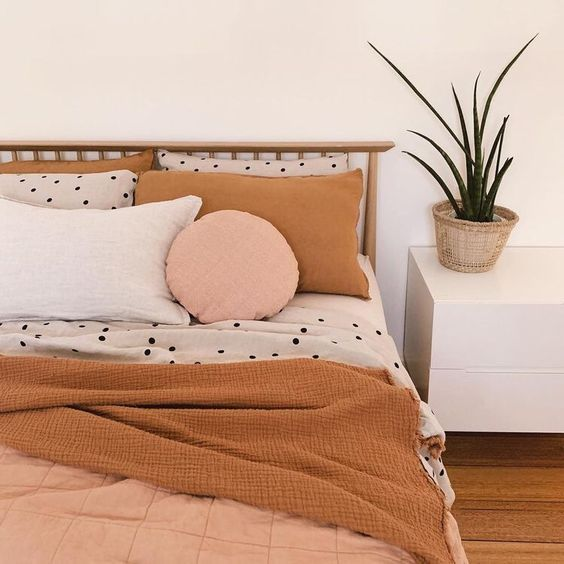 The polka dots on the bed create just enough differentiation with the monochrome pillows while maintaining harmony.
