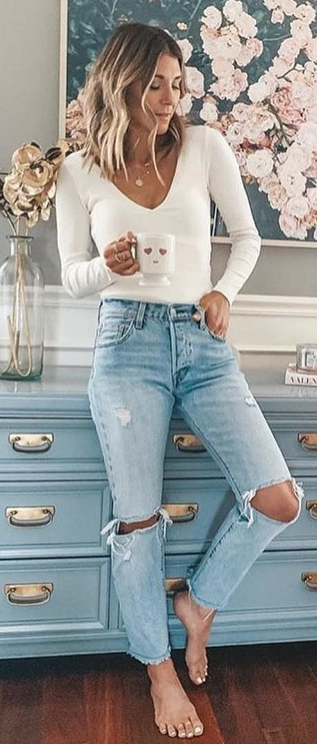 white V-neck top and distressed denim bottoms #spring #outfits