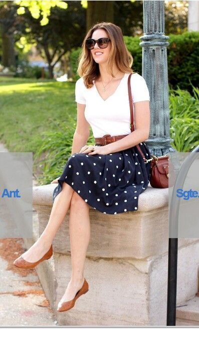 White top, polka dots skirt and brown accessories