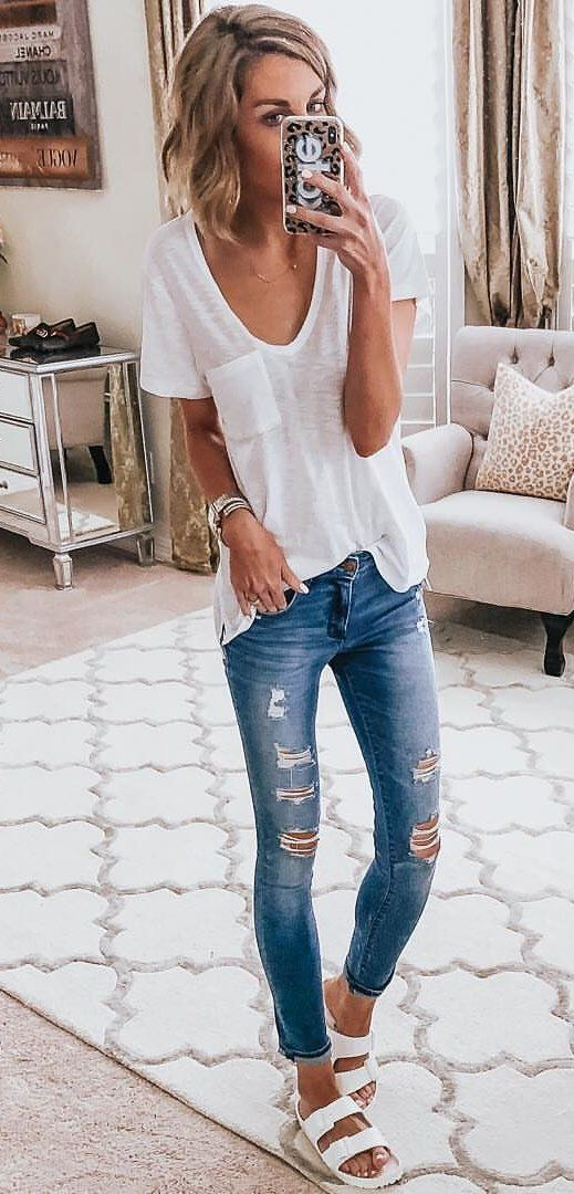 white V-neck cap-sleeved shirt and distressed blue jeans #spring #outfits