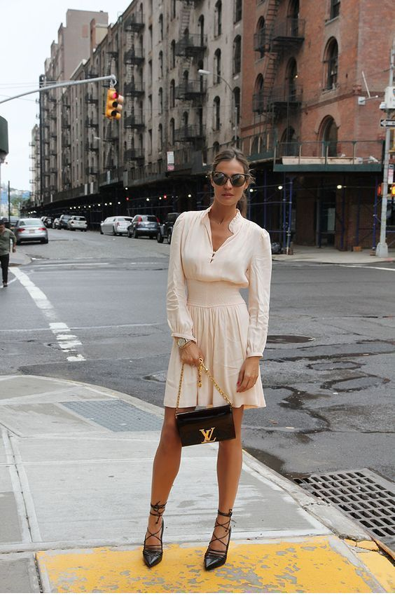 A very cute white dress with black accessories