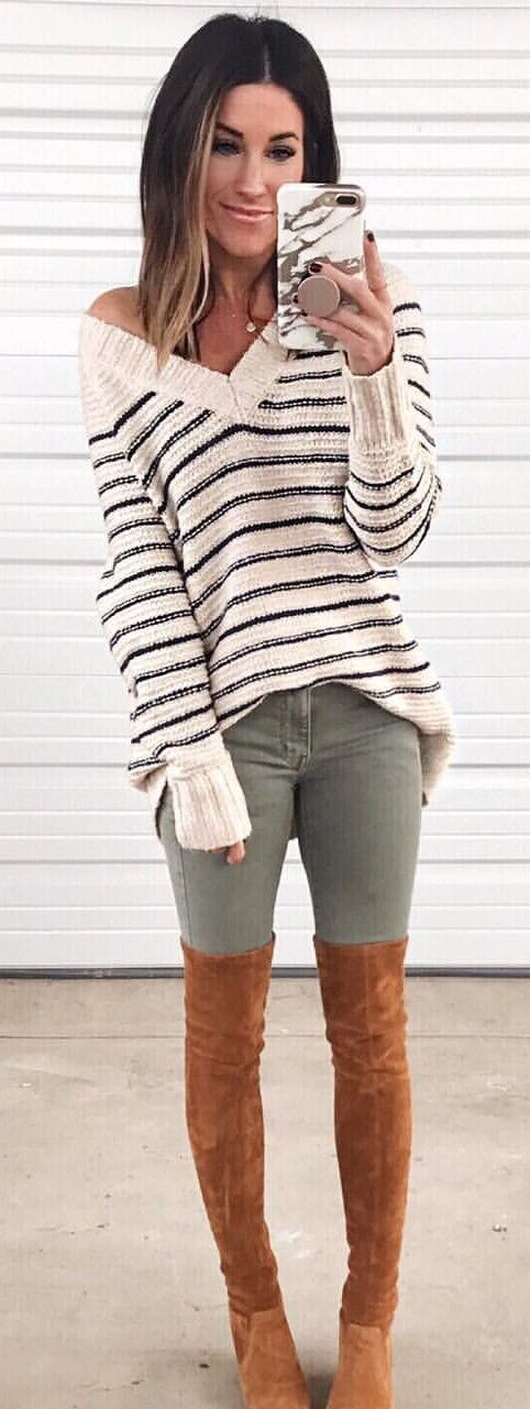 white and black striped sweater and gray jeans