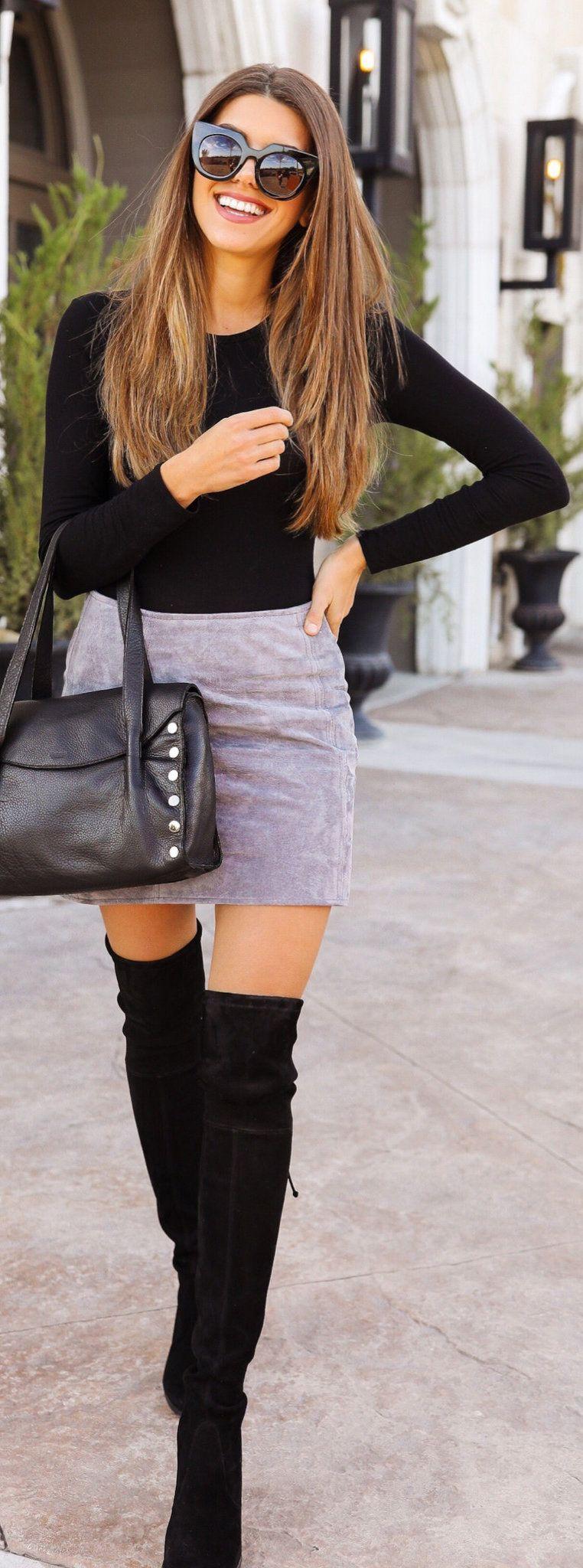 black crew-neck long-sleeved shirt and gray miniskirt
