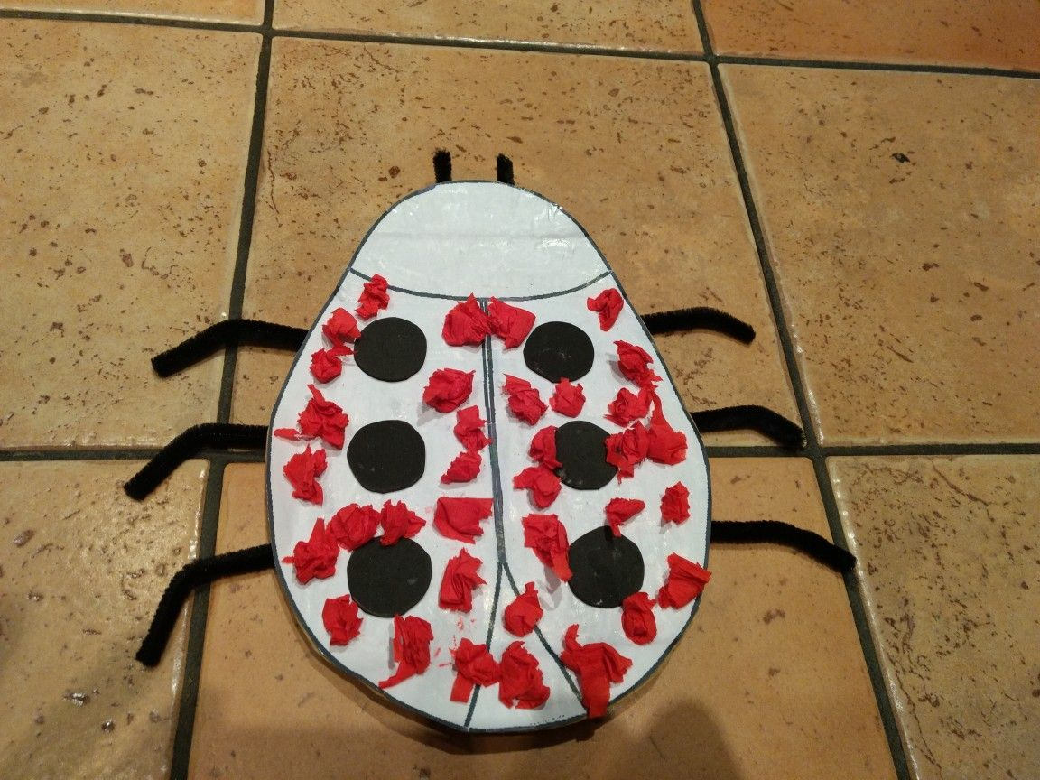 A ladybird made by my toddler using glue and crêpe paper