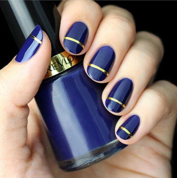 An elegant looking royal blue and gold themed matte polish with hints of metallic strips.