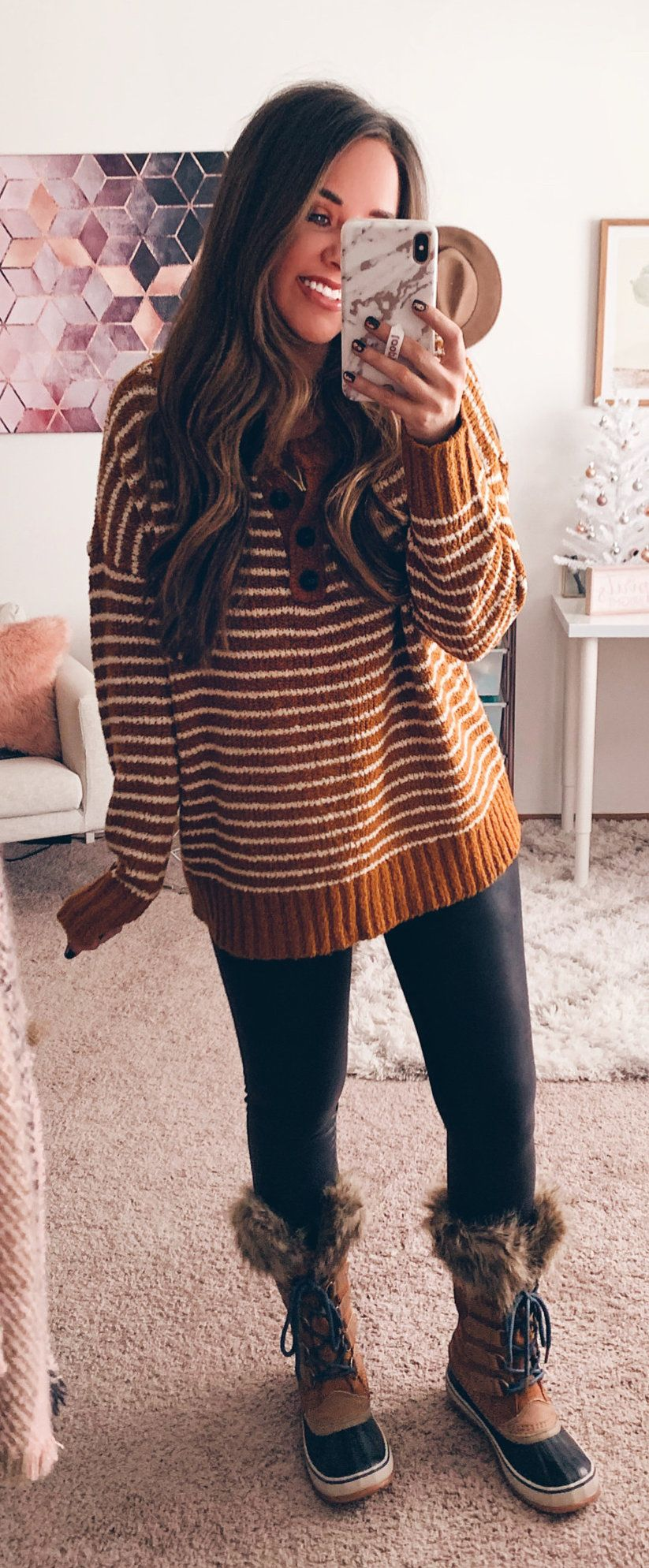brown and white striped knit sweater and black pants
