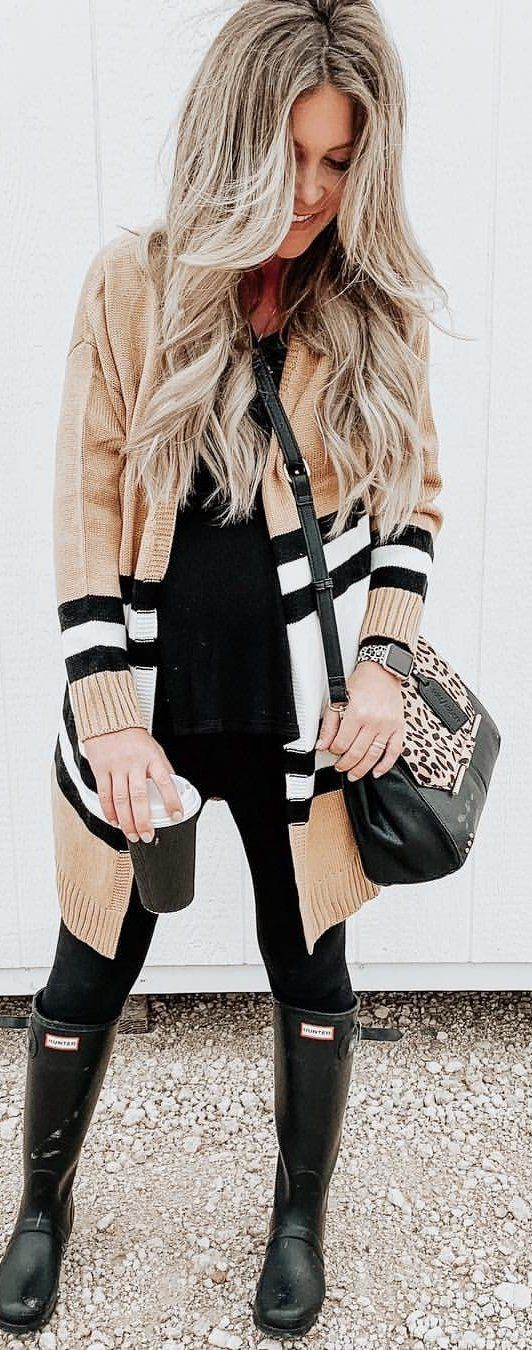 Burberry cardigan, black pants, and pair of boots