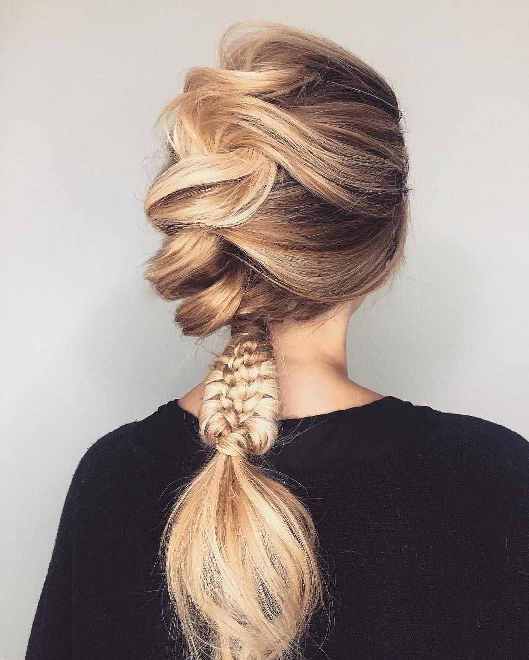 So much love for Wella Passionista Michael Grey's festival hair style. We're obsessed with this loose and lattice braid combination.