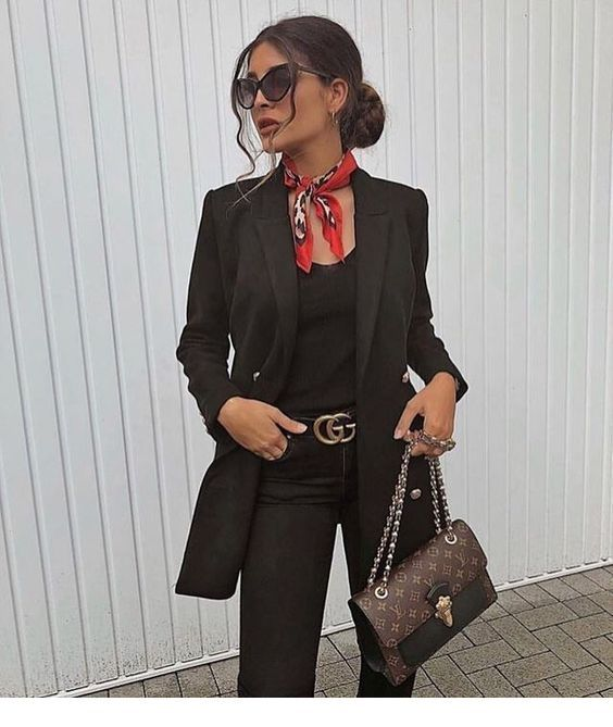Black outfit with a nice red scarf