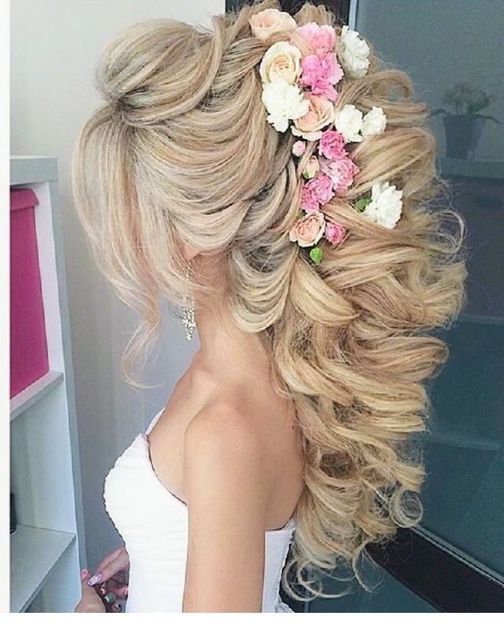 Amazing hairstyle with curls and flowers