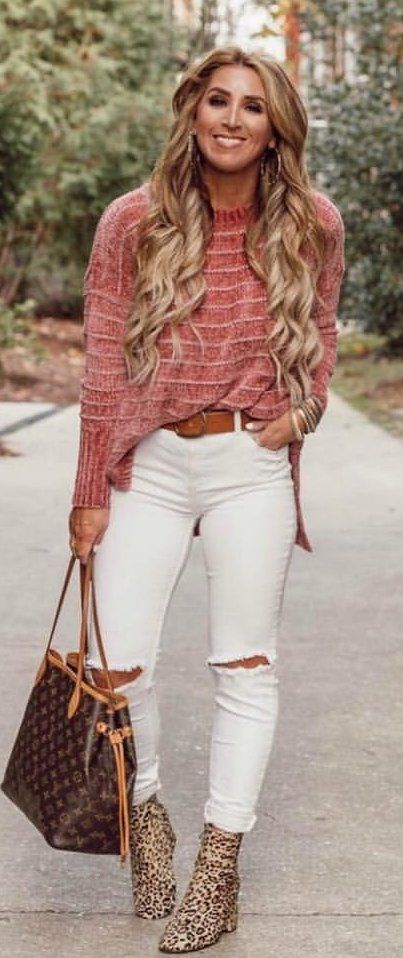 red long-sleeved top and distressed white jeans