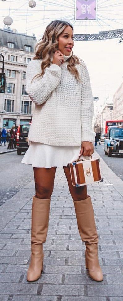 white sweater and pair of beige boots