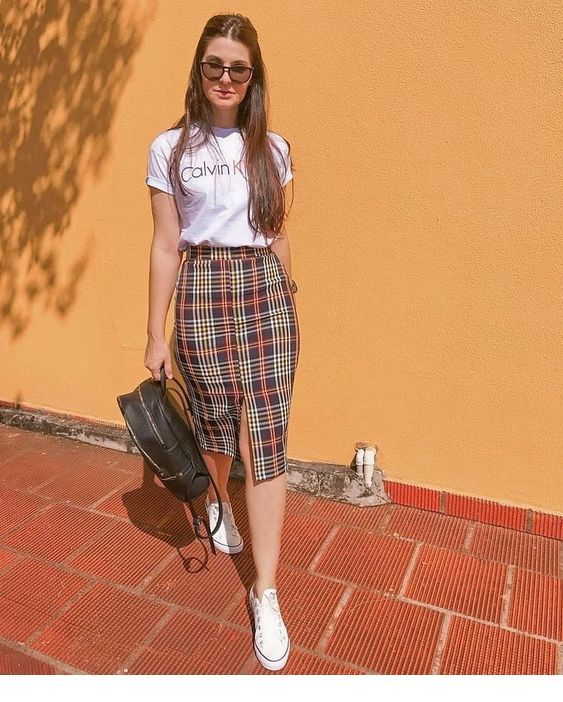 White t-shirt and plaid skirt