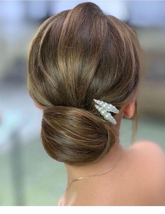 Low bun and pearl hair pin