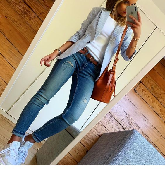 White top, grey blazer and blue jeans