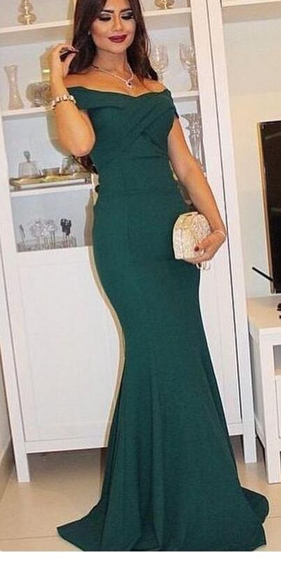 Long green dress and a gold bag