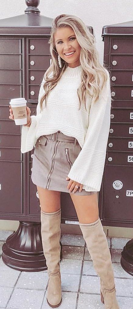 white long-sleeved blouse and gray denim skirts