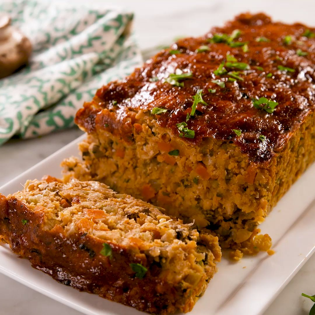 "This hearty ""meat loaf"" is packed with veggies and protein. We're in love! Serve it with a side of rosemary roasted potatoes and oven-roasted brussels sprouts for a truly delicious (and suuuper nutritious) vegan feast! Get the recipe at Delish.com. #delish #easy #recipe #best #vegan #meatloaf #chickpea #simple #mushrooms #thanksgiving #"