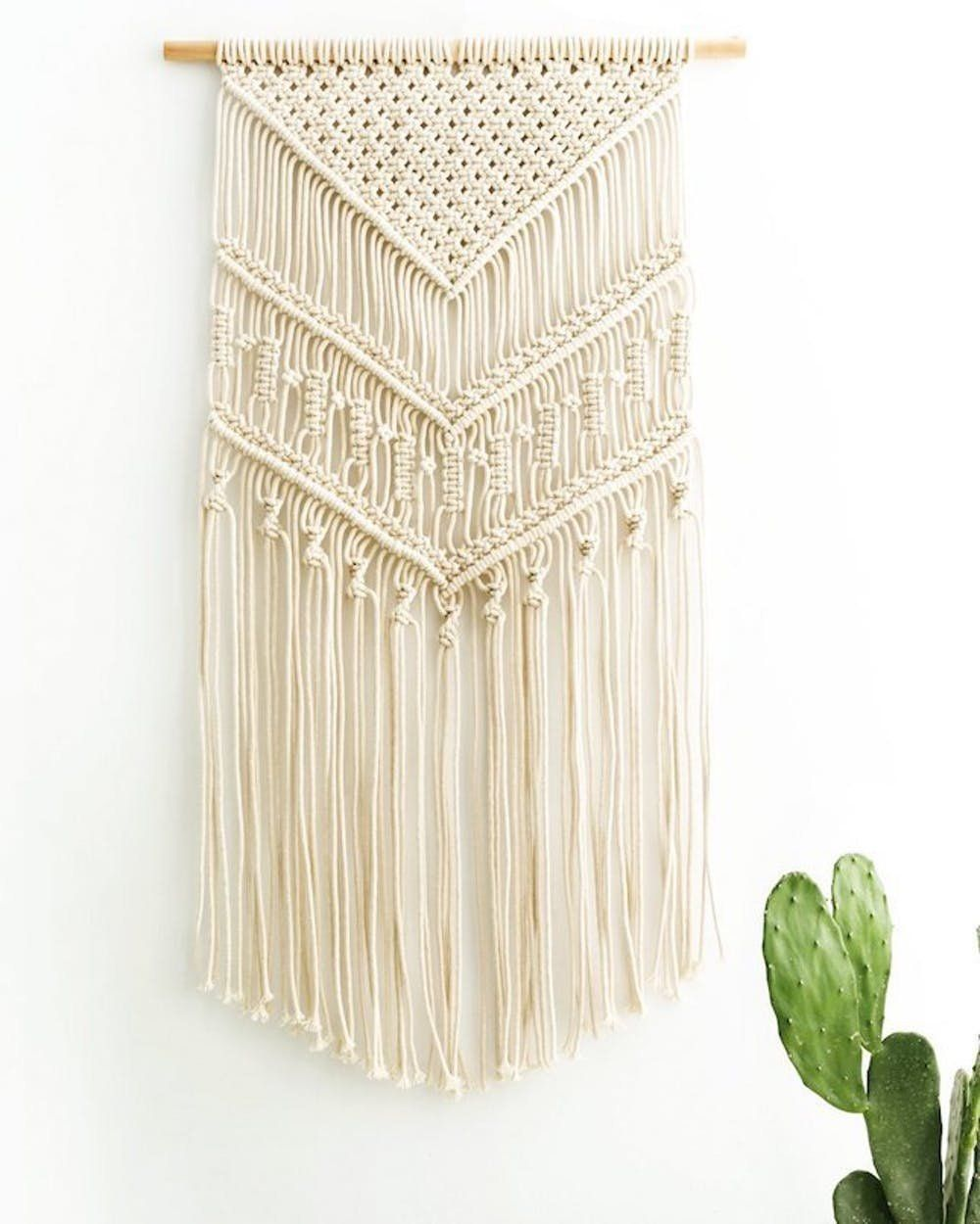 40 housewarming gift ideas that'll make you the best guest ever, including these woven wall hanging.