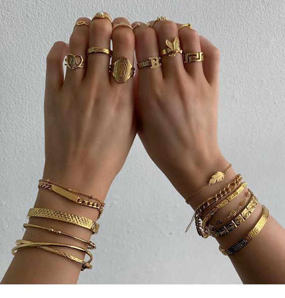 Gold everywhere, bracelets and rings