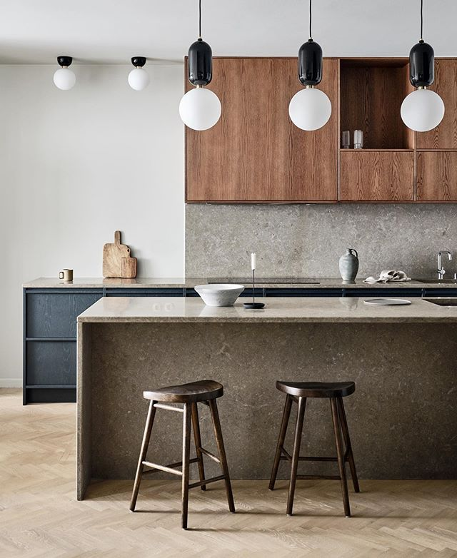 """Our latest project, """"The Painted Oak"""". A linear, nature-inspired oak kitchen, painted in a moody dark blue color, where the oak shine through and creates a surface that catches the light.⠀ ⠀ The countertop, a limestone in a cold tone, creates harmony with the cabinets and together with the⠀ warm oak they enhance the modern feel of the kitchen.⠀ ⠀ Styling: @carolinesandstrom_ ⠀ Photo: @andreapapiniphotographer"""