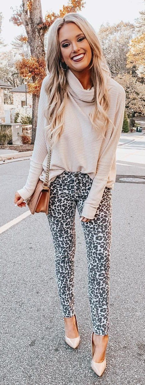 beige sweater and black and white leopard print fitted pants