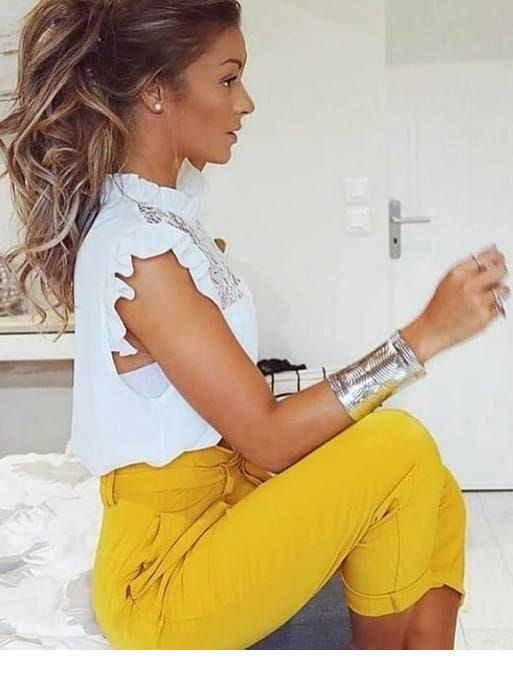 Nice yellow pants, white top and ponytail