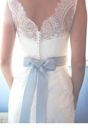 Amazing wedding dress with grey back bow