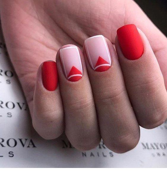 Matte red nails with geometric print