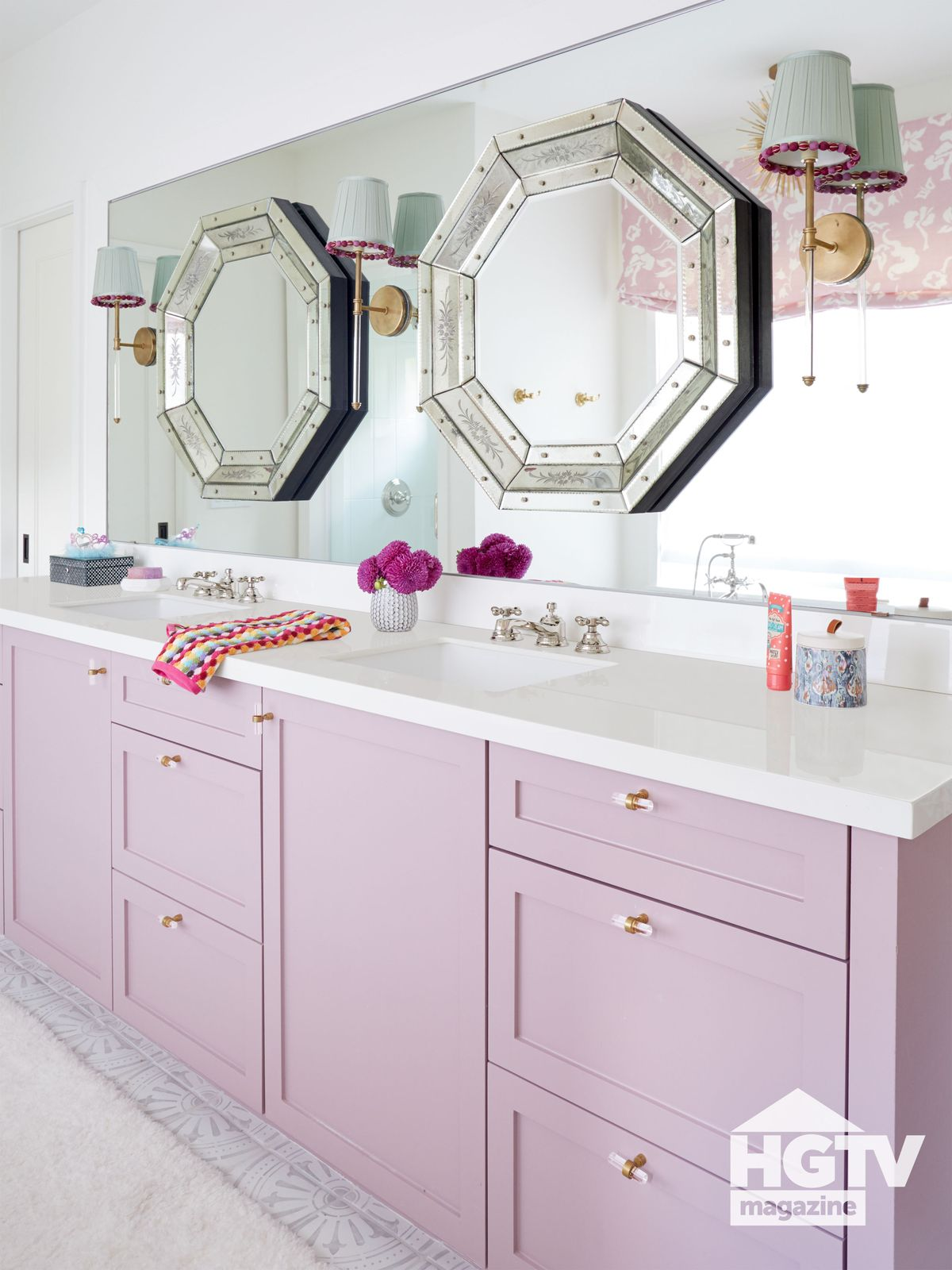 A purple and white girl's bathroom from HGTV Magazine