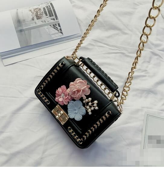 Black little bag with some flowers