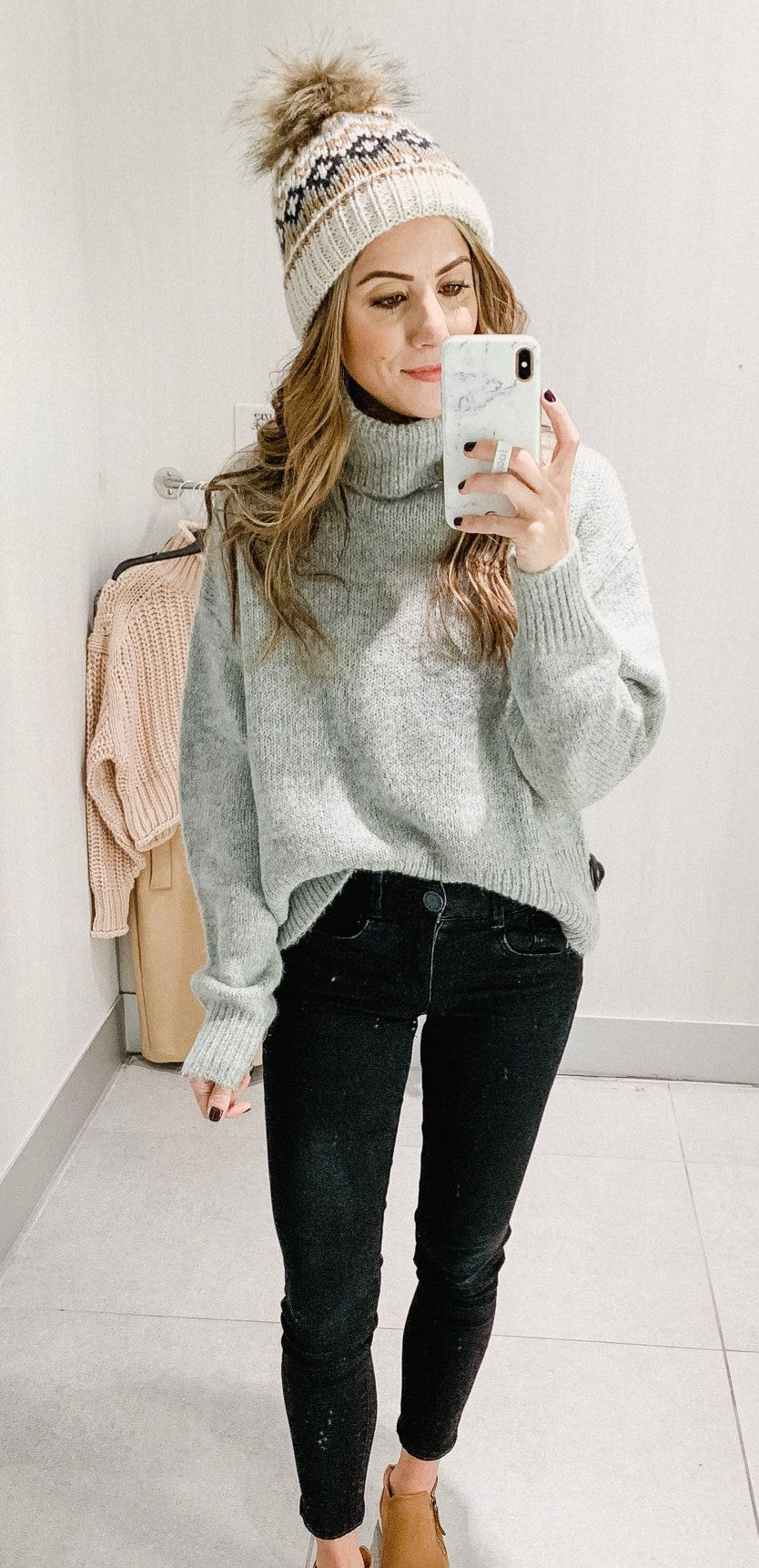 gray turtle-neck sweatshirt and black denim jeans