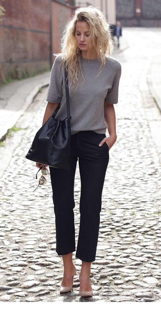 Grey top, black pants and messy hair