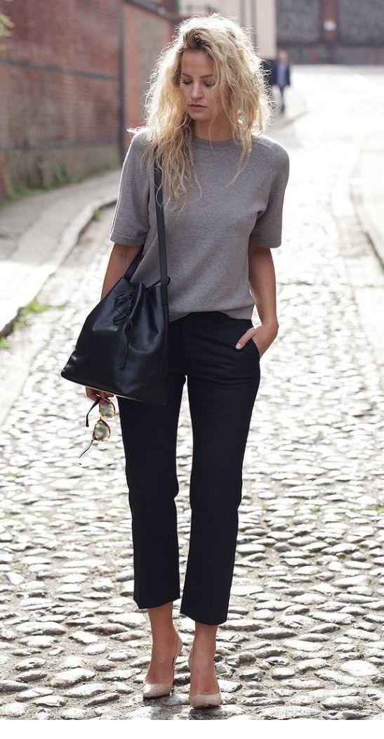 Grey top, black pants and messy hair
