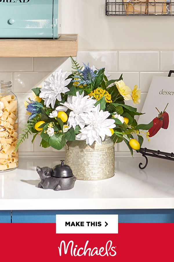 General Store Kitchen Floral Arrangement - A lemon-themed arrangement is the perfect touch to any space accented with general store décor. Keep it fresh looking with yellow, white and green.