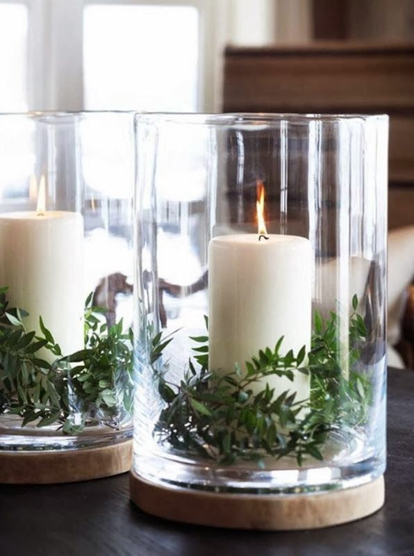 Simple candles and greenery in hurricanes for Christmas